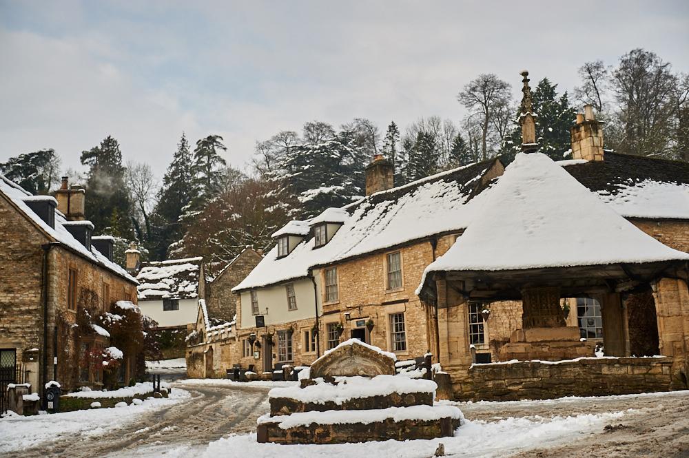 castle combe, the cotswolds, wiltshire, england, uk, winter, snow, winter wonderland, cottages, market cross