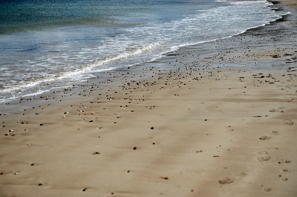 Visiting Talmine Bay in Sutherland, the North of Scotland and taking a break at the turquoise sea and white beach.