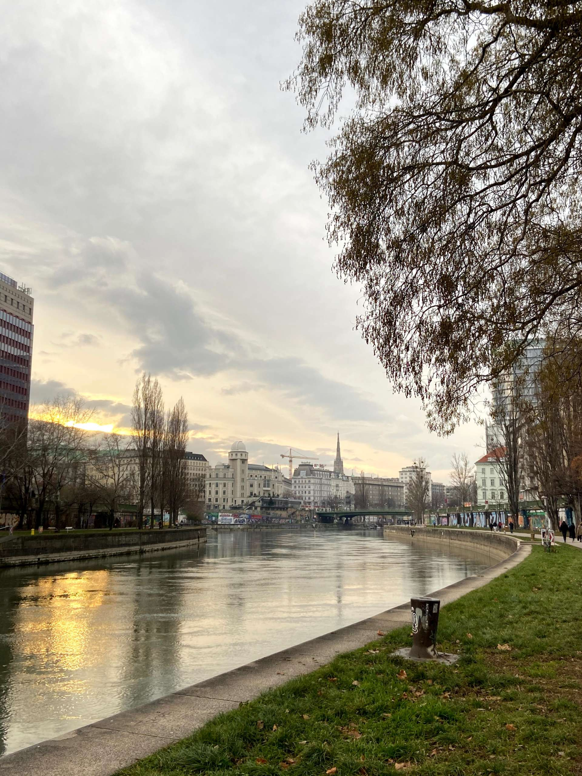 walking along the donaukanal in vienna, witha view of the first district